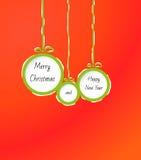Σφαίρες με τη Χαρούμενα Χριστούγεννα και καλή χρονιά Στοκ εικόνα με δικαίωμα ελεύθερης χρήσης