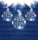 Σφαίρες Χριστουγέννων που γίνονται snowflakes στο μπλε ξύλινο υπόβαθρο απεικόνιση αποθεμάτων