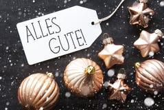 Σφαίρες Χριστουγέννων χαλκού, Snowflakes, καλύτερες ευχές μέσων Alles Gute Στοκ Φωτογραφία