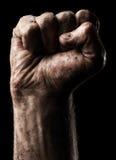 Σφιγγμένη αρσενικό πυγμή Στοκ εικόνα με δικαίωμα ελεύθερης χρήσης
