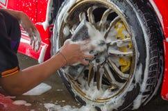 Σφουγγάρι πλυσίματος αυτοκινήτων χεριών Στοκ Φωτογραφία