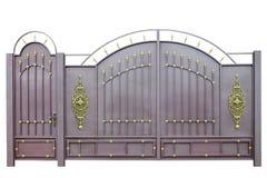 Σφυρηλατημένες πύλες και πόρτα από τη διακόσμηση στοκ εικόνα με δικαίωμα ελεύθερης χρήσης