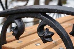 Σφυρηλατημένο σίδηρος armrest στο Μαύρο Στοκ εικόνα με δικαίωμα ελεύθερης χρήσης