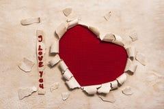 Σχέδιο εμβλημάτων τέχνης στη μορφή της καρδιάς στο παλαιό έγγραφο με τις λέξεις Ι Lo Στοκ φωτογραφία με δικαίωμα ελεύθερης χρήσης