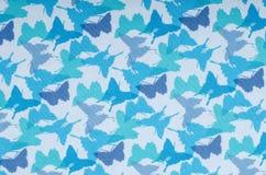 Σχέδιο πεταλούδων Μικρή μπλε τυπωμένη ύλη πεταλούδων ως υπόβαθρο Στοκ φωτογραφία με δικαίωμα ελεύθερης χρήσης