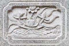 Σχέδιο Lotus στον τοίχο πετρών Στοκ Εικόνες