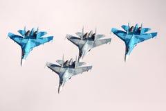 Σχηματισμός τεσσάρων Sukhoi SU-27 που παρουσιάζεται σε 100 έτη επετείου των ρωσικών Πολεμικών Αεροποριών σε Zhukovsky Στοκ Εικόνα