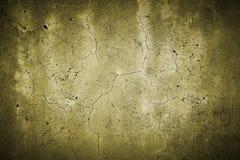 Σχισμένος συμπαγής τοίχος κίτρινος στοκ φωτογραφία