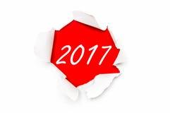 Σχισμένο έγγραφο με τις γραπτές λέξεις νέο έτος 2017 στοκ εικόνα