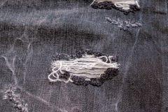 Σχισμένο μαύρο υπόβαθρο τζιν Στοκ εικόνες με δικαίωμα ελεύθερης χρήσης