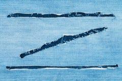Σχισμένο ύφασμα τζιν με μορφή του Ζ στοκ εικόνα