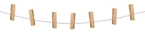 Σχοινί επτά γραμμών ενδυμάτων καρφιτσών ενδυμάτων ξύλινοι γόμφοι Στοκ εικόνες με δικαίωμα ελεύθερης χρήσης