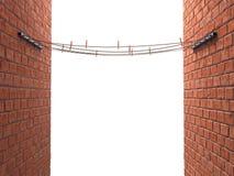 Σχοινιά με τα clothespins στις στάσεις μεταξύ δύο τοίχων σπασιμάτων Στοκ φωτογραφία με δικαίωμα ελεύθερης χρήσης