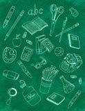 Σχολικά εικονίδια στον πίνακα κιμωλίας Στοκ Εικόνα
