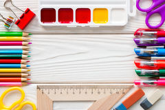 Σχολικές προμήθειες και μια θέση για το κείμενο Στοκ Εικόνες