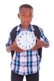 Σχολικό αγόρι αφροαμερικάνων που κρατά ένα ρολόι - μαύροι Στοκ εικόνα με δικαίωμα ελεύθερης χρήσης