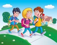 σχολικό περπάτημα βασικών κατσικιών Στοκ Εικόνες
