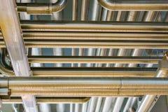 Σωλήνες στο βιομηχανικό εργαστήριο Στοκ Εικόνες