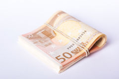σωρός 50 ευρο- τραπεζογραμματίων που τυλίγεται και που κυλιέται Στοκ Φωτογραφίες