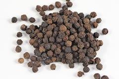 Σωρός μαύρα peppercorns Στοκ Εικόνες
