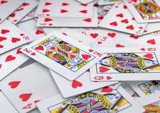Σωρός της ακολουθίας καρδιών καρτών που βρίσκεται στον πίνακα Στοκ Φωτογραφία