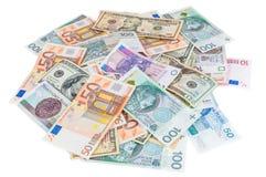 Σωρός του δολαρίου, του ευρώ και των zloty τραπεζογραμματίων στιλβωτικής ουσίας στοκ εικόνες με δικαίωμα ελεύθερης χρήσης