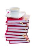 Σωρός των βιβλίων με το φλιτζάνι του καφέ Στοκ Φωτογραφία