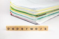 Σωρός των εγγράφων με τη γραφική εργασία λέξης Στοκ Εικόνες