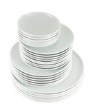 Σωρός των καθαρών άσπρων πιάτων πιάτων που απομονώνονται Στοκ Εικόνα