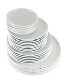Σωρός των καθαρών άσπρων πιάτων πιάτων που απομονώνονται Στοκ Εικόνες