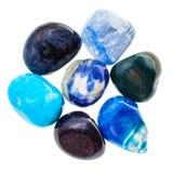Σωρός των μπλε φυσικών ορυκτών πολύτιμων λίθων που απομονώνονται Στοκ Φωτογραφία