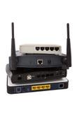 Σωρός των συσκευών δικτύων στην άσπρη ανασκόπηση Στοκ Φωτογραφία