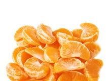 Σωρός των τμημάτων φετών tangerine που απομονώνονται Στοκ Φωτογραφία