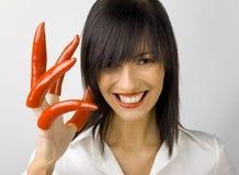 σωστή γυναίκα πιπεριών χερ Στοκ Φωτογραφίες