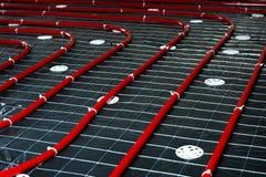 Σωλήνας θέρμανσης πατωμάτων Εγκατάσταση των συστημάτων εφαρμοσμένης μηχανικής σε ένα bui Στοκ Εικόνες