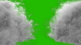 Σύγκρουση δύο ρευμάτων του καπνού μπροστά από μια πράσινη οθόνη ελεύθερη απεικόνιση δικαιώματος