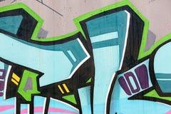 σύγχρονη οδός τέχνης ζωηρόχρωμα γκράφιτι που χρωματίζουν στον τοίχο Στοκ εικόνες με δικαίωμα ελεύθερης χρήσης