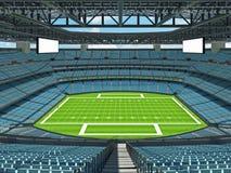Σύγχρονο στάδιο αμερικανικού ποδοσφαίρου με τα μπλε καθίσματα ουρανού στοκ εικόνες