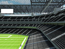 Σύγχρονο στάδιο αμερικανικού ποδοσφαίρου με τα μαύρα καθίσματα Στοκ φωτογραφία με δικαίωμα ελεύθερης χρήσης