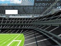 Σύγχρονο στάδιο αμερικανικού ποδοσφαίρου με τα μαύρα καθίσματα Στοκ Φωτογραφίες