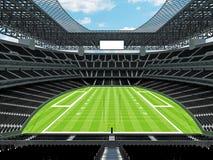 Σύγχρονο στάδιο αμερικανικού ποδοσφαίρου με τα μαύρα καθίσματα Στοκ Φωτογραφία