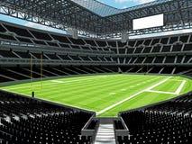 Σύγχρονο στάδιο αμερικανικού ποδοσφαίρου με τα μαύρα καθίσματα Στοκ εικόνα με δικαίωμα ελεύθερης χρήσης