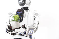 Σύγχρονο cyborg που κρατά λίγο χορτάρι Στοκ Φωτογραφίες