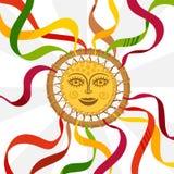 Σύμβολο Shrovetide που διακοσμείται με τον ρόδα-ήλιο κορδελλών με ένα ανθρώπινο πρόσωπο ελεύθερη απεικόνιση δικαιώματος