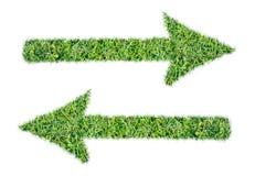Σύμβολο βελών την πράσινη χλόη που απομονώνεται από Στοκ φωτογραφία με δικαίωμα ελεύθερης χρήσης