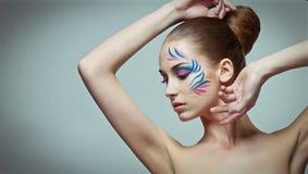 Σύνθεση μόδας με την τέχνη προσώπου. Στοκ Φωτογραφία