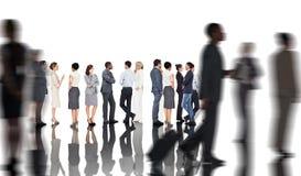 Σύνθετη εικόνα πολλών επιχειρηματιών που στέκονται σε μια γραμμή Στοκ εικόνα με δικαίωμα ελεύθερης χρήσης