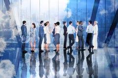 Σύνθετη εικόνα πολλών επιχειρηματιών που στέκονται σε μια γραμμή Στοκ φωτογραφία με δικαίωμα ελεύθερης χρήσης