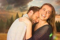 Σύνθετη εικόνα στενού επάνω του ευτυχούς νέου ζεύγους Στοκ Εικόνα