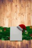 Σύνθετη εικόνα της γιρλάντας διακοσμήσεων Χριστουγέννων κλάδων έλατου Στοκ φωτογραφίες με δικαίωμα ελεύθερης χρήσης